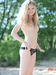 Beautiful blonde teen hottie stripping clothes and posing absolutely naked on the beach.